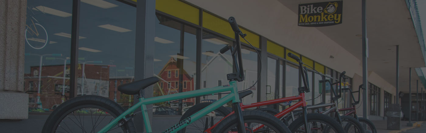 Colorful bikes lined up in front of the bike monkey store in truro, nova scotia
